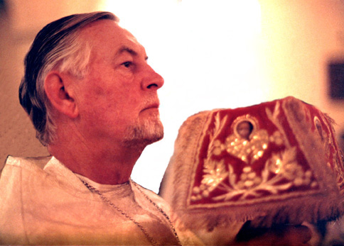 Protopresbyter Alexander Schmemann celebrating the Divine Liturgy. Photograph taken by M. Roshak